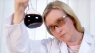 Woman in lab mixing substances video