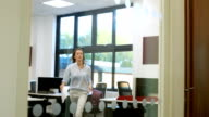 Woman in large modern office video