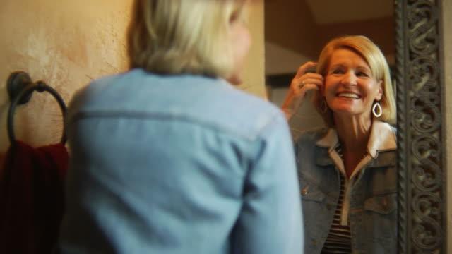 Woman in mirror happy video