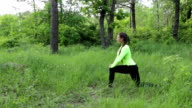 Woman in nature doing exercises. Healthy lifestyle video