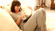Woman in Pyjamas Using a Digital Tablet on the bed video