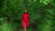 Woman in red dress in forest video
