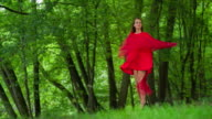 Woman in red dress Twirling in forest video