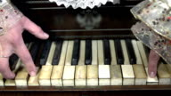 HD SLOW: Woman in romanesque clothes pressing keys video