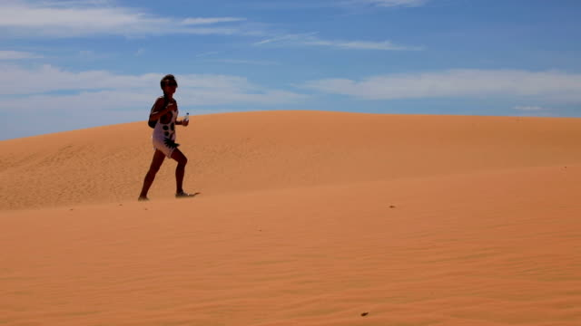 Woman in sand dunes video