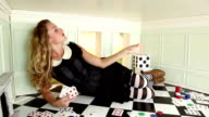 Woman in small room throwing cards video