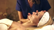 Woman in spa getting facial massage video