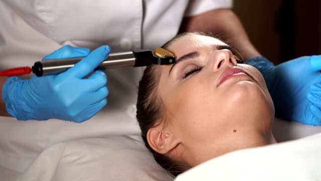 Woman in spa salon getting facial rejuvenation procedure. Mesoporation. video