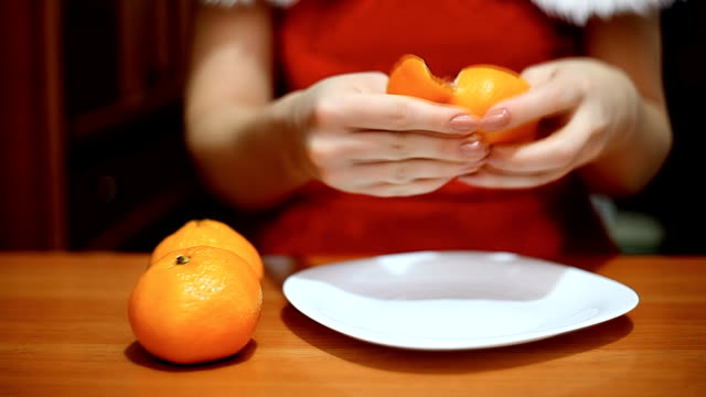 woman in suit Snow Maiden clears a tangerine video