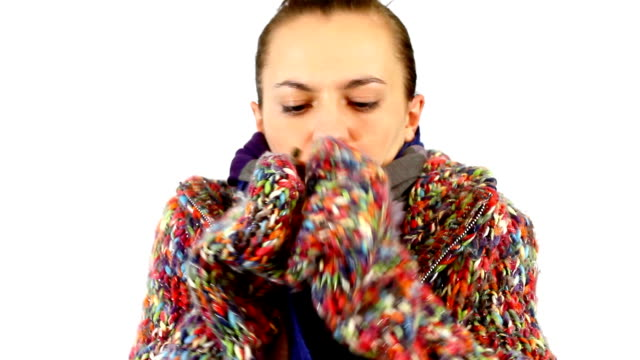 Woman in sweater embrace herself and shiver video