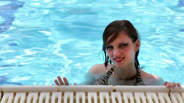 Woman in swimming pool video