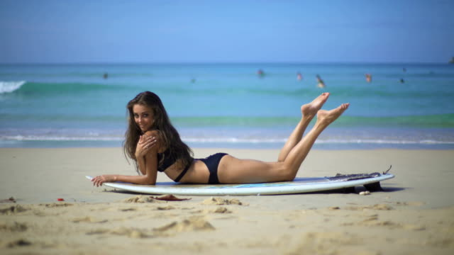 Woman In Swimsuit With Surfboard video