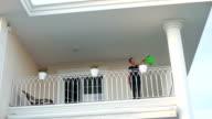 HD: Woman in the balcony video