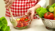 Woman In The Kitchen Mixing Vegetables Salad video