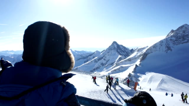 Woman in the mountains looking at beautiful view in ski resort video