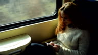 Woman in train using phone video