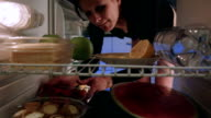Woman in underwear takes cakes from the fridge video