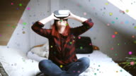 Woman in virtual reality helmet on bed. VR glasses. video
