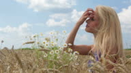 HD: Woman in wheat meadow enjoy video