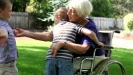 Woman in wheelchair with grandchildren video