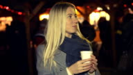 Woman in white with cup of coffee at the winter weather, Christmas Fair video