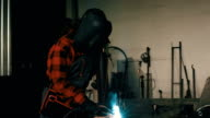 Woman in workshop welding 4K video