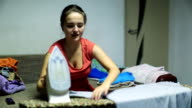 Woman Irons Clothes video