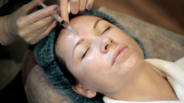 Woman is getting a mesotherapy of her face video