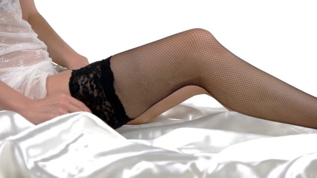Woman is putting on stocking. video