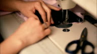 Woman is Sewing Clothes video