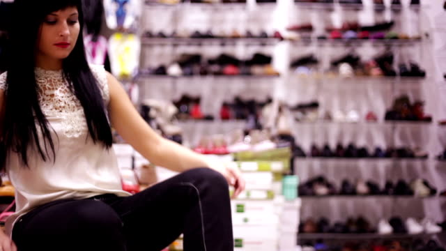 Woman is trying a pair of shoes on video