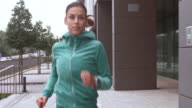 SLO MO TS Woman jogging along a city street video