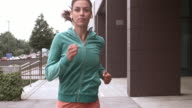 SLO MO TS Woman jogging and listening to music video