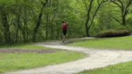 Woman jogging at the park with weights video