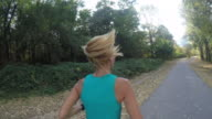 Woman jogging in nature video