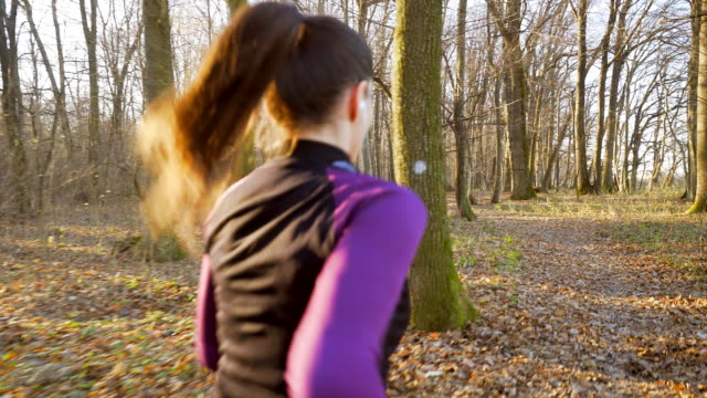 Woman jogging in the nature. video