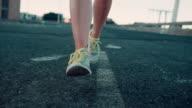 Woman jogging in urban setting video