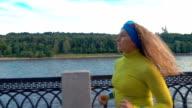 woman jogging near city river video