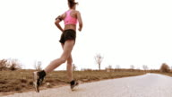 SLO MO TS Woman jogging on a countryside road video
