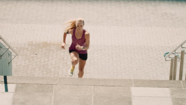 Woman jogging on stairs video
