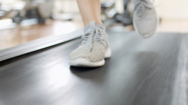 Woman jogging on track,Indoor exsercise video