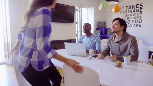 Woman Joining Colleagues in Creative Workspace video