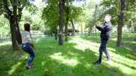 Woman jumps and man makes photo of it iand show it to her n slow motion video