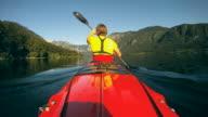 HD: Woman kayaking a lake. video