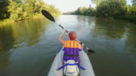 Woman kayaking on the river video