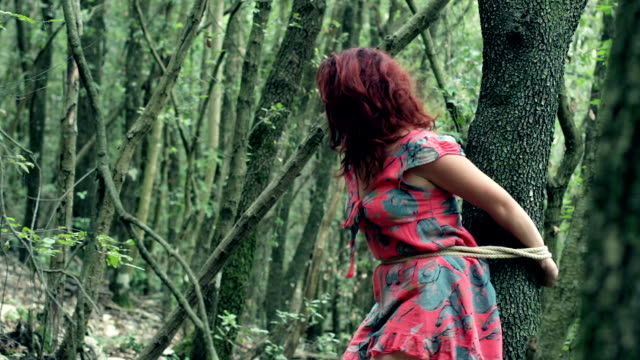 woman kidnapped and tied to a tree shouts ( cries) looking for help video