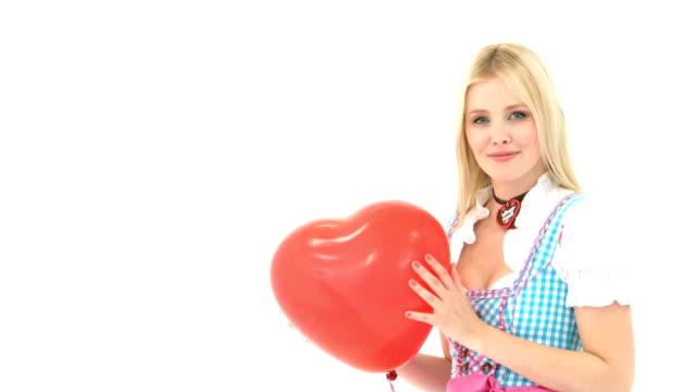 Woman kisses heart ballon before it is set free video
