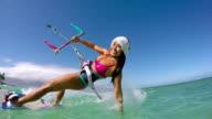 Woman Kite Surfing In Santa Claus Hat video