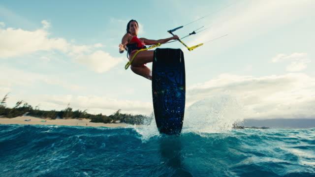 Woman Kiteboarding at Sunset video