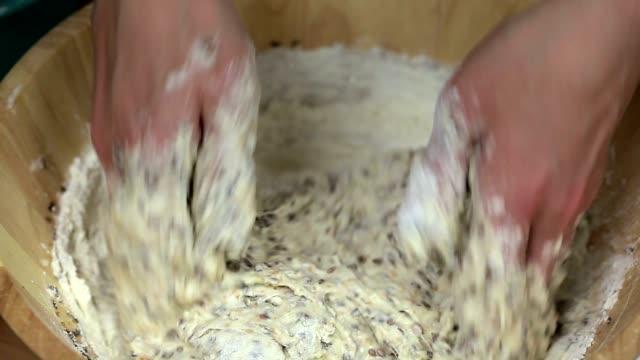 Woman kneading the bread dough video